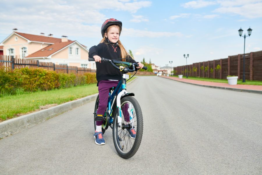 girl riding bike YSAQ8TK e1575411965440