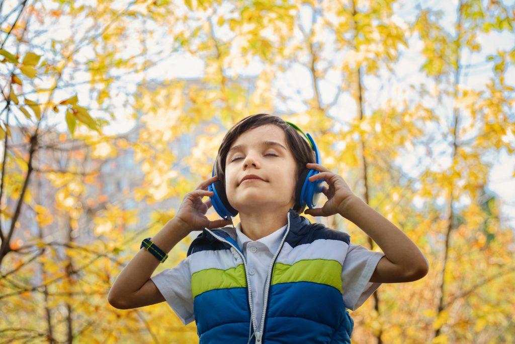 photo of a boy listening in headphones 1490844